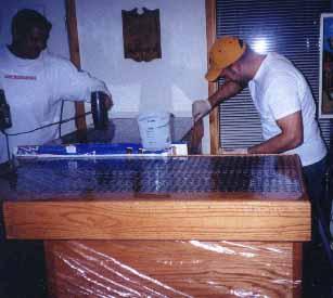 Buddies Helping Finish The Bar Top
