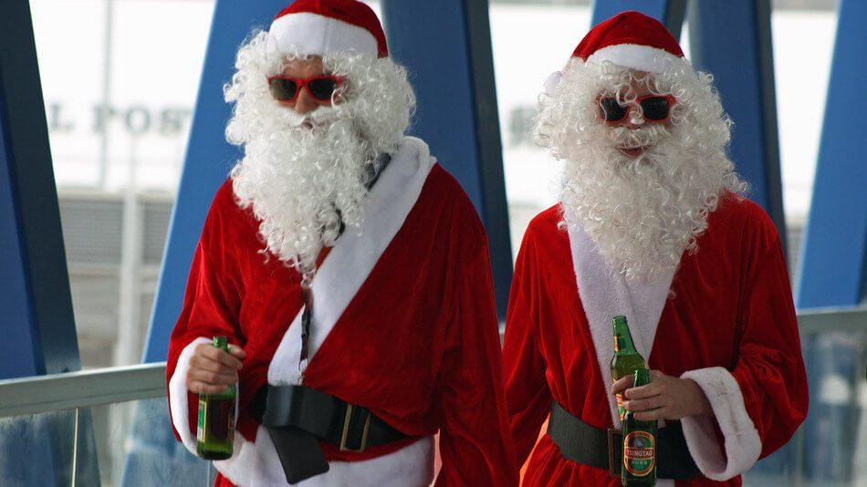 Santa Clauses Drinking Beer
