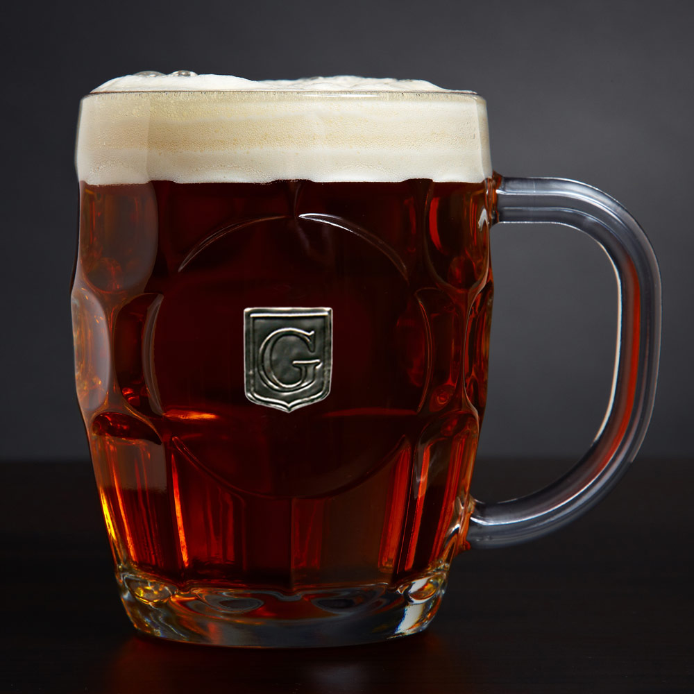 Give a handsome gift to last a lifetime with our personalized beer mug. Crafted from sturdy glass, fixed with a stately pewter crest, each of these monogrammed beer mugs comes with the initial of your choice. A large handle and wide mouth allow for tasty, #mug