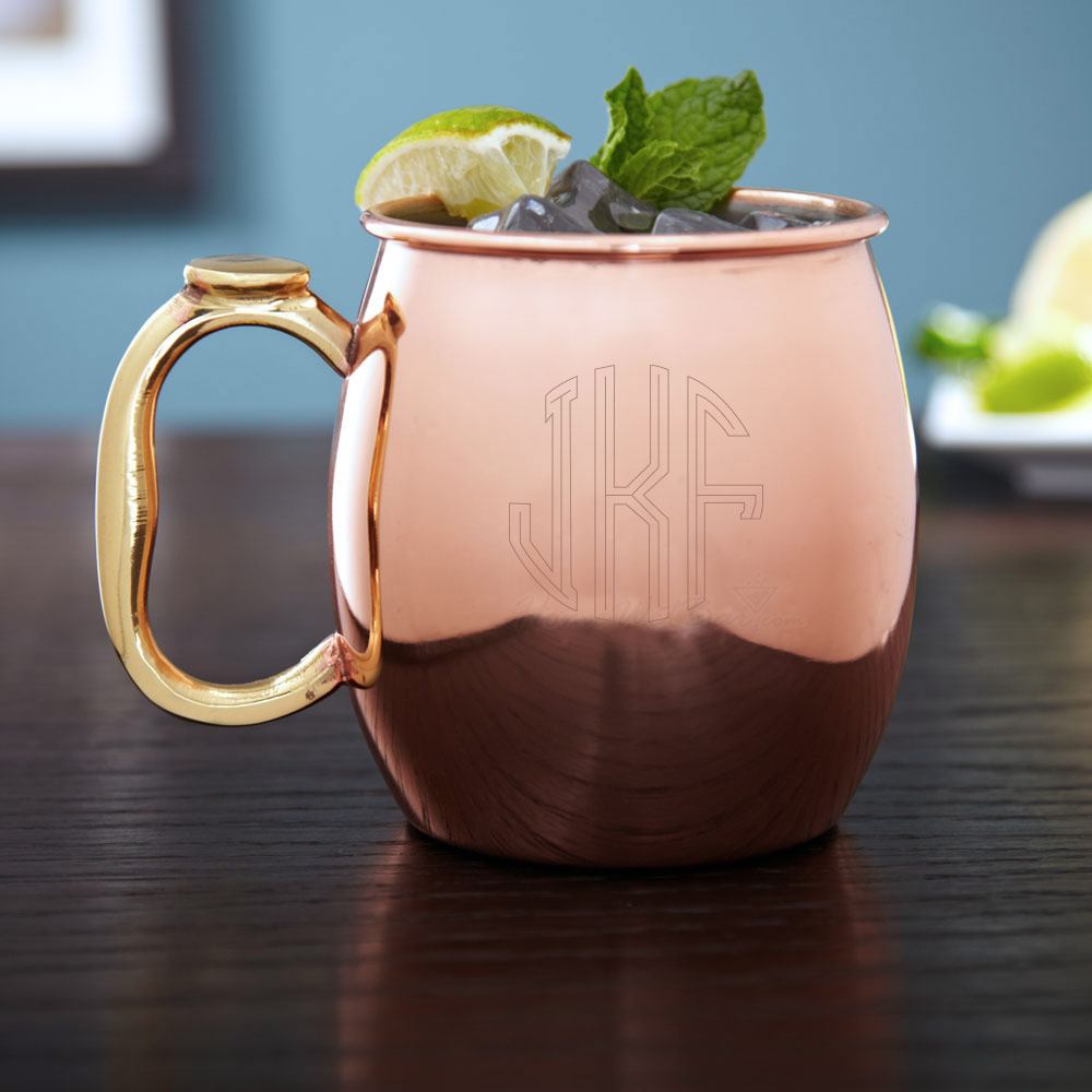 Give your limes, ginger, and vodka a worthy home with our Circle Monogram Moscow Mule Mug. Copper plated, and lined with a stainless steel interior, this copper mug is not only handsome but can hold a generous 20 ounces. Featuring our circle monogram desi #%20