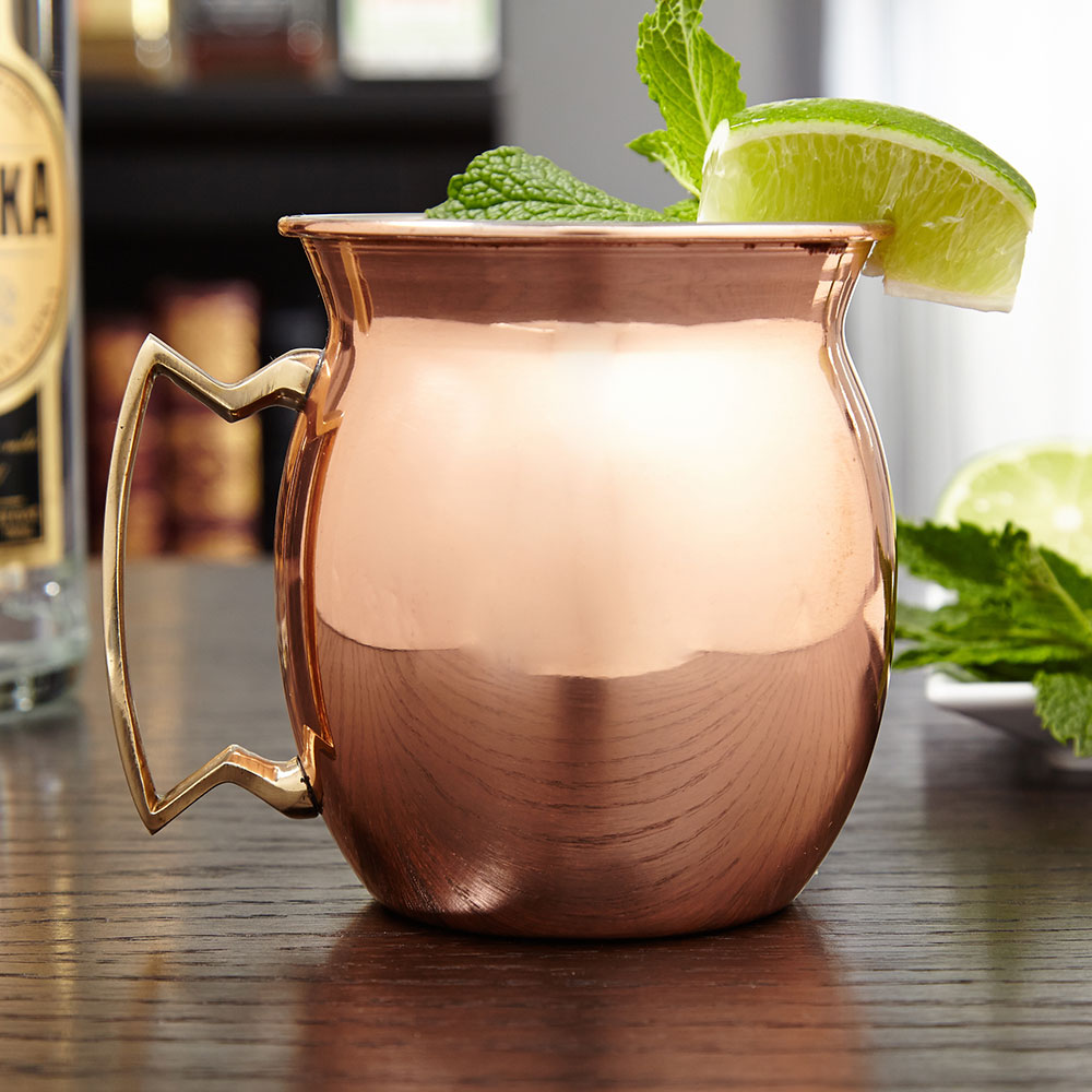 Drink a toast to the classic cocktail in this sleek Moscow Mule mug. Made in the decades-old tradition of copper drinking mugs, these Moscow Mule cups feature a rounded design, with a flared lip and sturdy geometric handle. Made of solid copper, this Mosc #mug