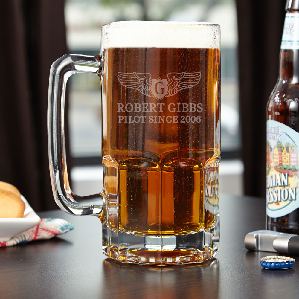 A beer glass that is sure to soar far above the others in your glassware collection, you will have more than your fill of beer when drinking from our colossal beer mug. Engraved with a traditional Pilotwings design, it is custom made just for your or your #mug