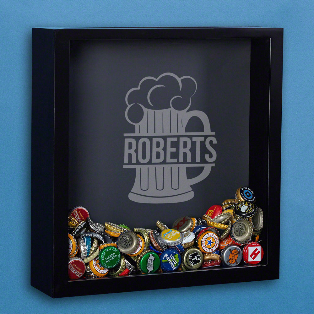 We all have that one friend with bottle caps all over the floors and table tops, or you may be the guilty party yourself. Put those bottle caps to better use with this personalized beer cap shadow box! This custom shadow box comes engraved with a large fr #mug