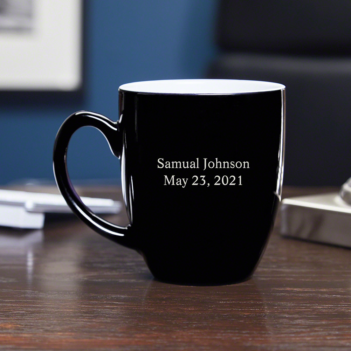 Even if your desk is full of mugs and tumblers, a true coffee lover knows you can never be too ready for that morning cup. Our personalized coffee mug features a smooth black glaze, custom engraved with up to two lines of custom text. You can add a name, #mug