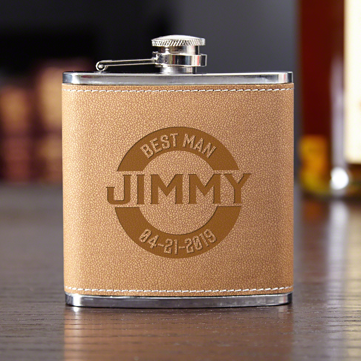 A flask is a classic gift for any member of your wedding party. Give them a chance to enjoy their favorite liquor while everyone else is waiting in line for the open bar. This personalized best man flask is crafted from stainless-steel wrapped in cocoa le #best
