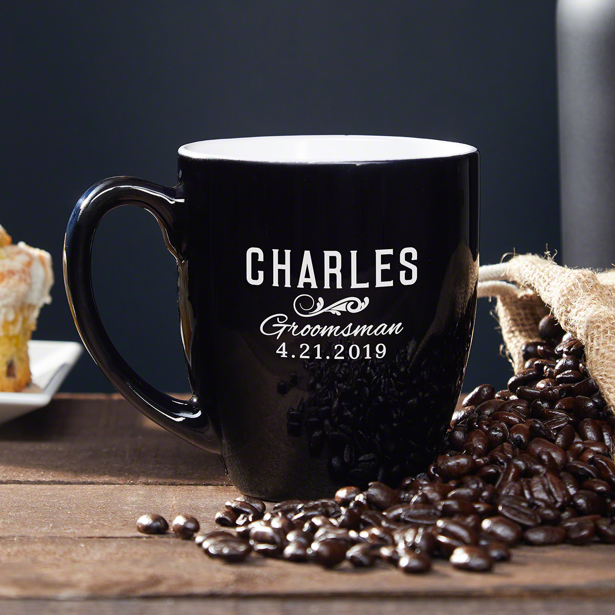 You want to give your groomsmen a nice gift as a thank you for being part of your wedding, but you want it to be something that they will actually enjoy and use. Why not a personalized coffee mug? This groomsman mug is engraved with a title, name, and the #mug