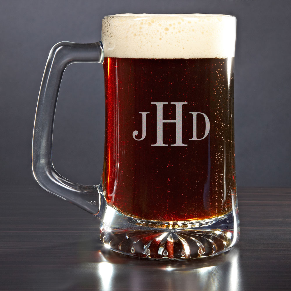 A handsome gift that your groomsmen, father, or husband will love. Crafted from sturdy glass our monogrammed beer mug has a heavy duty weighted base with charming dimples. This monogrammed beer mug shows off a sturdy handle that any guy would be proud to #mug